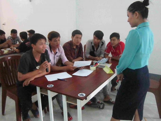 Nguyen Van Liet (L) in a class sponsored by Save the Children in Vietnam.
